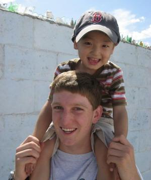 Volunteer and child in Mongolia