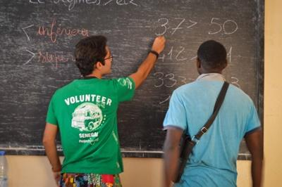 A Projects Abroad volunteer teaches a former talibe at a micro-finance centre in Senegal
