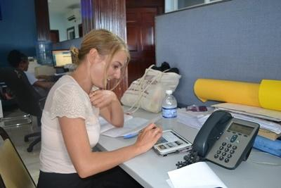 A Projects Abroad Journalism volunteer conducts research for a news story at her internship abroad in Jamaica
