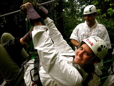 Volunteer explores the Costa Rican rainforest during a canopy tour