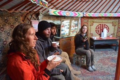 A group of volunteers in a traditional ger in Mongolia