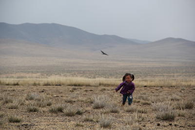 A nomad child runs and plays outdoors