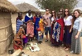 A group of volunteers spends time in a Maasai community, practising their Swahili language skills.