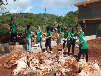 Projects Abroad volunteers build a new playground to contribute to Early Childhood Development at a care centre in Jamaica.