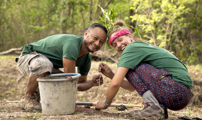 A Projects Abroad Conservation volunteer abroad in Costa Rica works with staff member on a reforestation project