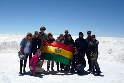 Projects Abroad volunteers hold the Bolivian flag