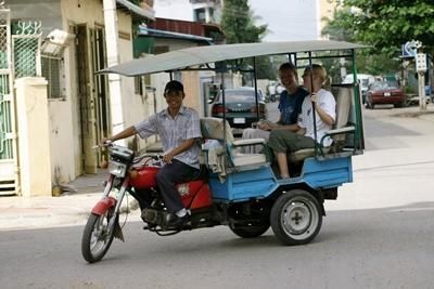 Two volunteers catching local transport in Cambodia