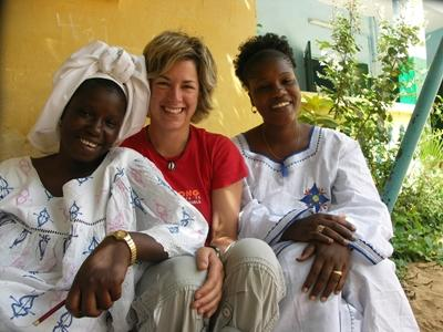 A volunteer in Senegal with two local teachers