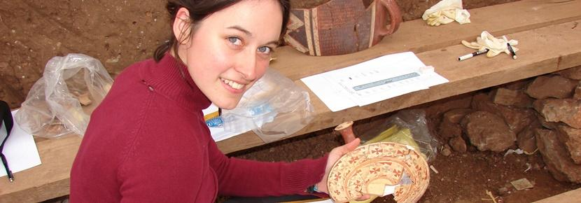 Archaeology volunteer sketches artefact