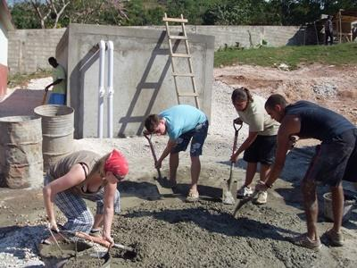 Volunteers build toilet facilities for schools in Jamaica