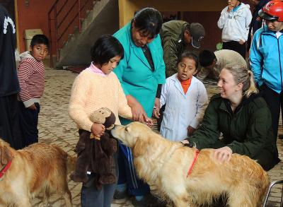 Therapy dog greets child at the care centre in Bolivia