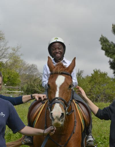 A boy takes part in a horse riding class on our Equine Therapy Project in South Africa.