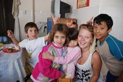 Care volunteer with a group of children at placement