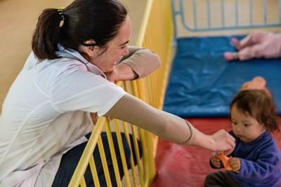 A Projects Abroad volunteer plays games with a child at a nutrition centre in Cochabamba