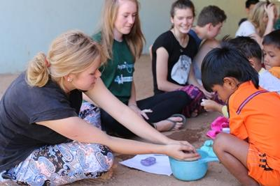 Volunteers in Cambodia teach the child to wash their hands
