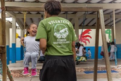 Projects Abroad Care volunteer and young girl play outside