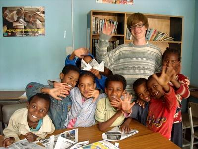 A volunteer in Ethiopia helps with arts & crafts