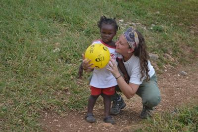 A care volunteer with a child in Jamaica