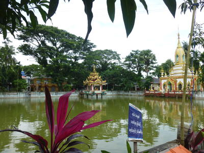 A lake and shrine at Dala Monastery in Myanmar