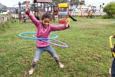Young girl playing outside at the Projects Abroad Care centre in Cape Town, South Africa