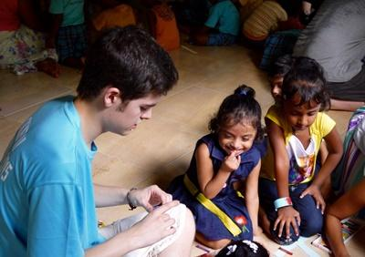 Projects Abroad volunteer does arts and crafts with children at Care placement in Sri Lanka