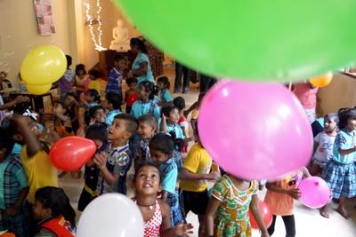 Children at a Projects Abroad Care placement in Sri Lanka play games with balloons
