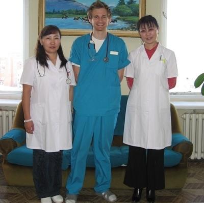 Volunteer with hospital staff.