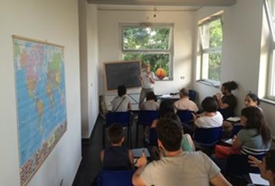 Students attend a lesson in a classroom