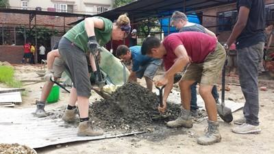Projects Abroad Disaster Relief volunteers assist with the building of a classroom in Kathmandu.