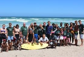 A group of Care & Community volunteers in South Africa work on a summer surfing programme with children over the Christmas break.