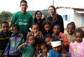 Children and volunteers at a Care and Conservation Christmas placement in Madagascar pose for a photo