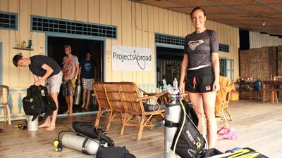 A Projects Abroad conservation volunteer prepares her scuba diving equipment in Cambodia