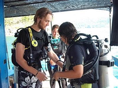 Volunteers prepare to dive in Thailand