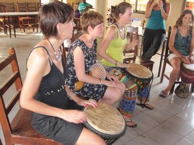 Volunteers take part in a music lesson in Togo