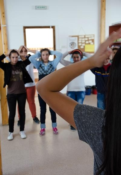 A volunteer on the Dance project teaches children in Romania