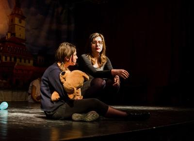 Two Romanian students appear on stage performing a play