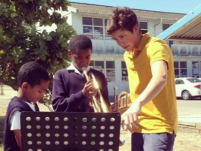 Volunteer and children in a music project in South Africa