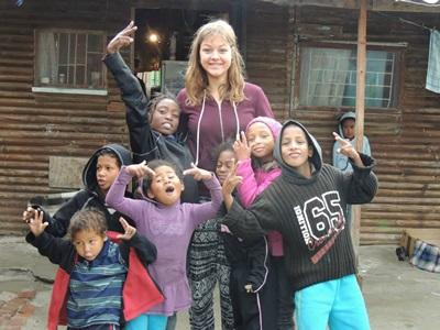 A volunteer with some local children at the Community project