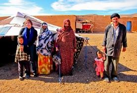 Moroccan Nomads pose for a picture at a placement in Morocco