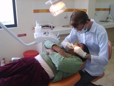 Dentistry Elective volunteer performs check-up on patient