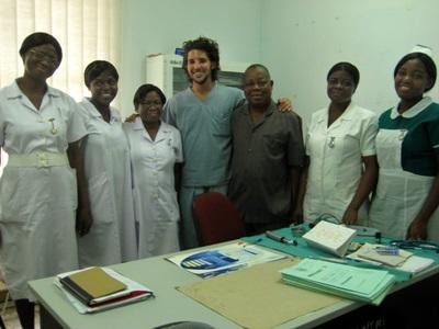Dentistry volunteer with staff at his placement in Ghana