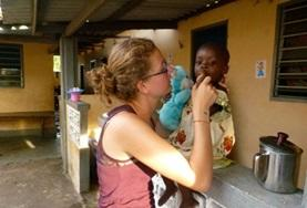 A dentistry student doing her elective in Togo examines a local child's teeth.
