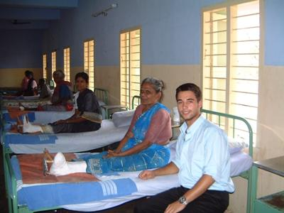 A medical student visits a patient recovery ward during his elective placement in India.