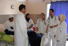 Medicine Elective volunteers discuss a patient at a placement in Morocco