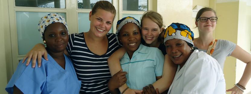 Midwifery volunteer with a newborn baby