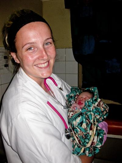 Midwifery volunteer with newborn Togolese baby
