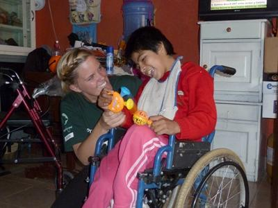 Nursing Elective volunteer with a boy at her placement