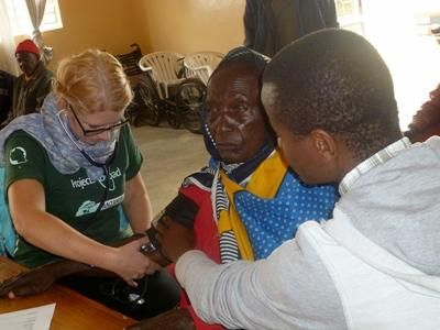 Nursing Elective volunteer takes a patient's blood pressure