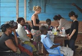 A Pharmacy Elective volunteer assists with outreach work at her placement in Ghana