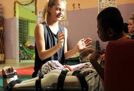 A Physiotherapy Elective volunteer works with a patient at her placement in Morocco